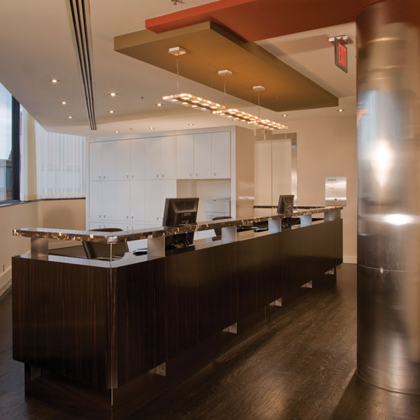 Custom reception desk for commercial office space design by Washington, DC architect and interior design firm Studio Santalla
