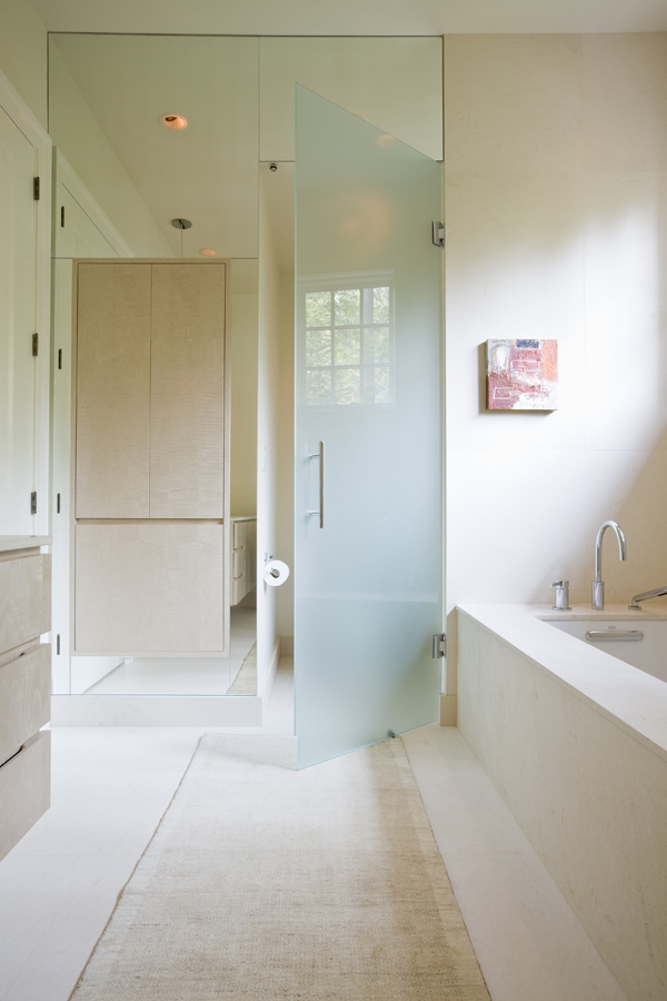 Contemporary bathroom by Washington, DC architects and interior designers, Studio Santalla features a glass enclosed watercloset and a floating vanity