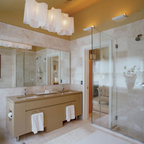 A custom vanity and glass shower complete this bathroom by Washington, DC interior design firm, Studio Santalla