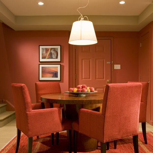 This dining room, by Washington, DC architecture firm, Studio Santalla utilizes bold colors and contemporary furniture