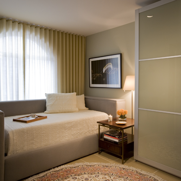 A tempurpedic adjustable bed and PAX wardrobe from IKEA have been given a custom touch by Washington, DC interior Design firm, Studio Santalla