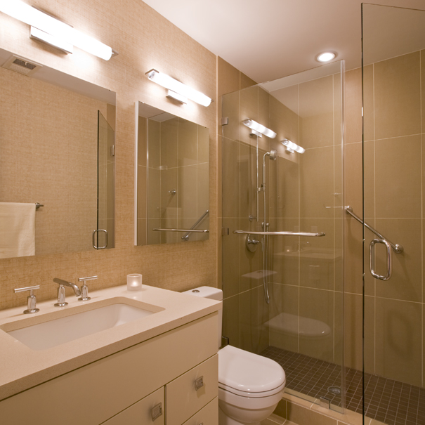 Studio Santalla's remodel of this bathroom included contemporary tile, neutral colors and plenty of light