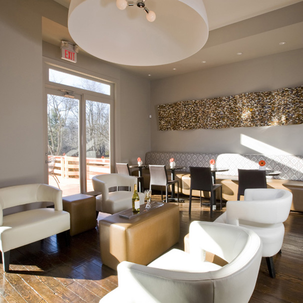 Contemporary pub with banquette seating and modern light fixture