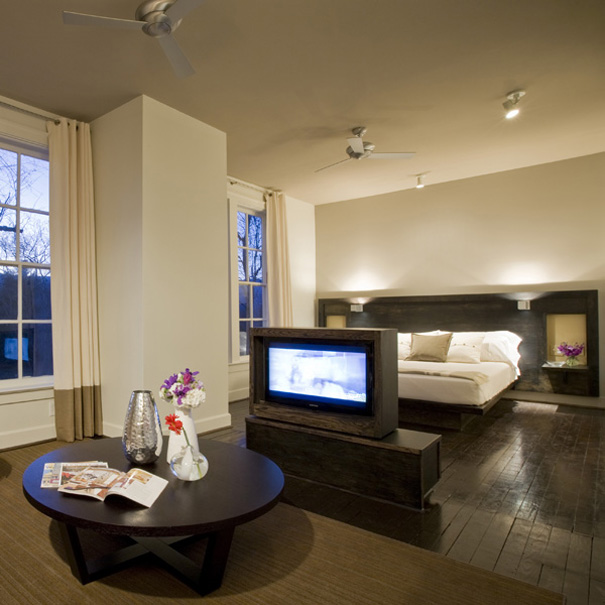 contemporary suite with built in bed and swiveling television
