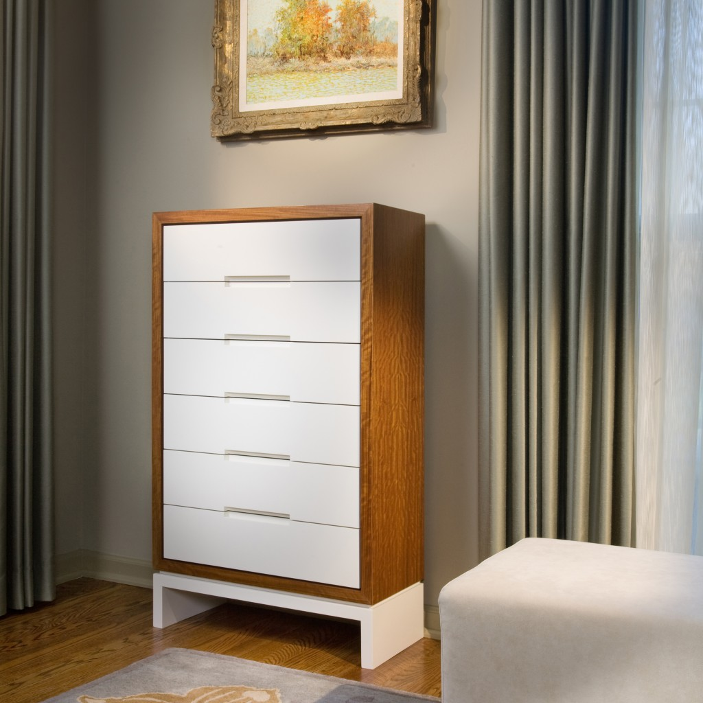 This custom designed dresser serves as a silver chest, housing the client's antique collection.