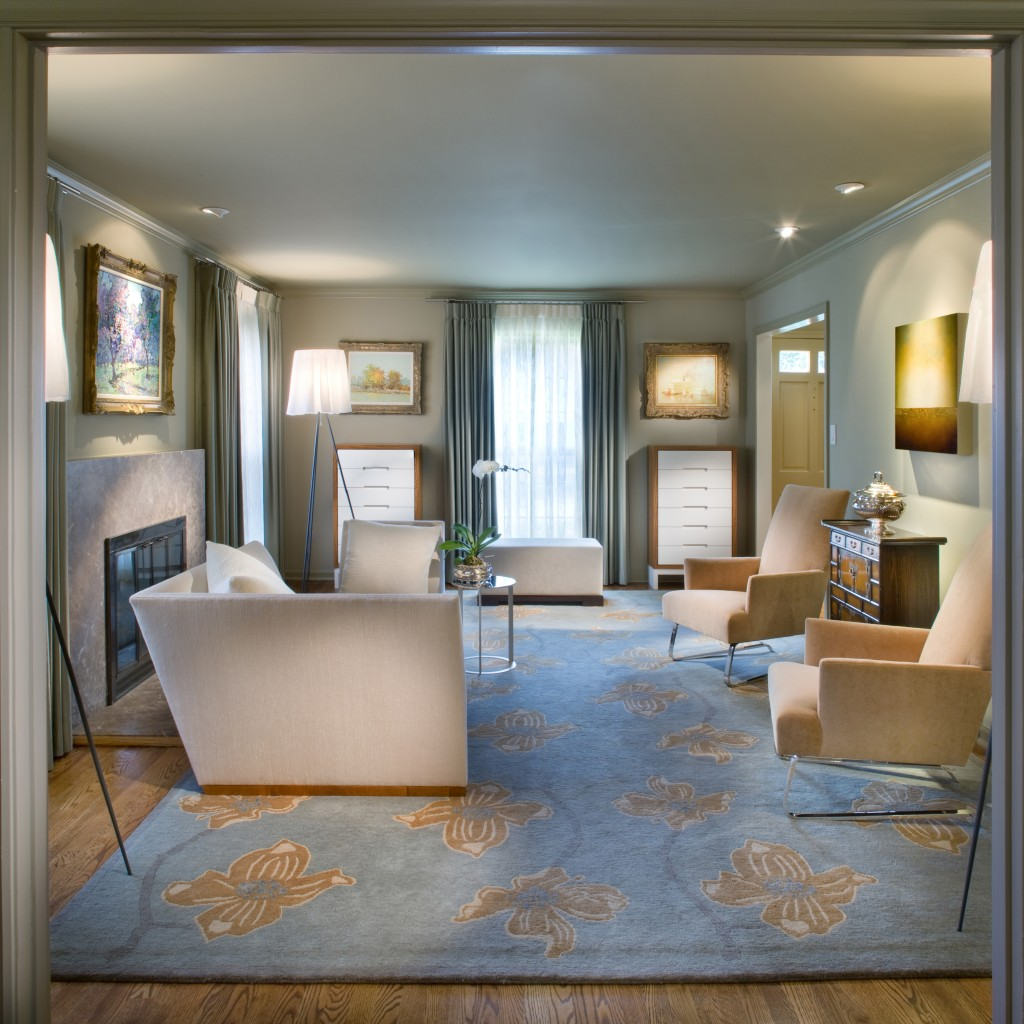 This Contemporary Sitting Room Features A Custom Designed Rug And Silver Chests Accompanied By