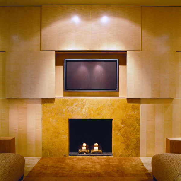Custom fireplace surround and media center with hidden television designed by contemporary Washington DC architecture and interior design firm, Studio Santalla