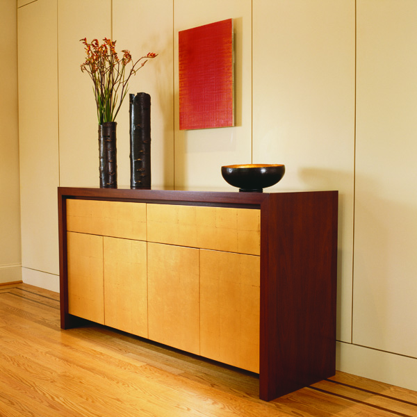 Studio Santalla custom designed this contemporary sideboard with mahogany and gold leaf