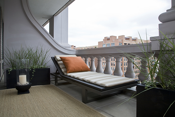 Studio Santalla selected an upscale chaise lounger and sisal rug to complete this zen terrace that offers views of Washington, DC