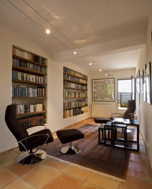 Washington, DC architect and interior design firm Studio Santalla created these recessed, niche bookcases for the library in this French town home renovation.
