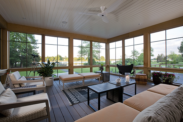 Screened deck with contemporary outdoor furnishings by Washington, DC Architecture and Interior Design firm Studio Santalla offers beautiful views of the Eastern Shore