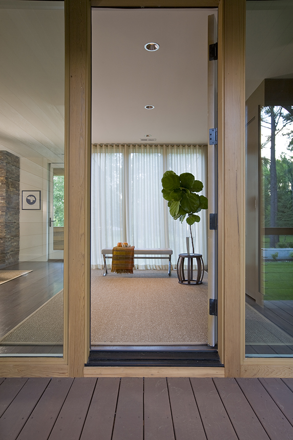 Simple and elegant entry with maxalto bench and fiddle leaf fig on the Eastern Shore by Washington, DC Architecture and Interior Design firm Studio Santalla