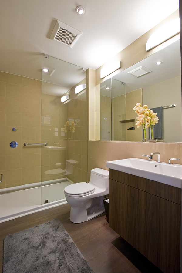 Bathroom with glass shower by Washington, DC Architecture and Interior Design firm Studio Santalla