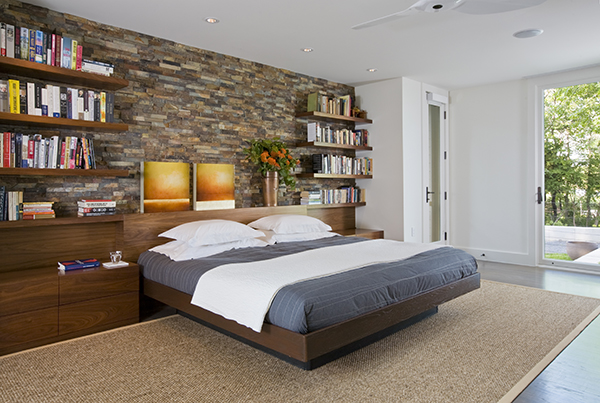 Luxurious bedroom with custom designed headboard on the Eastern Shore by Washington, DC Architecture and Interior Design firm Studio Santalla