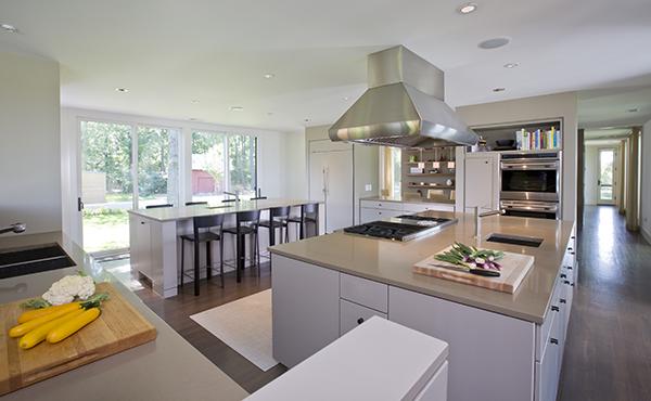 Massive, twin island kitchen in warm neutral colors on the Eastern Shore by Washington, DC Architecture and Interior Design firm Studio Santalla