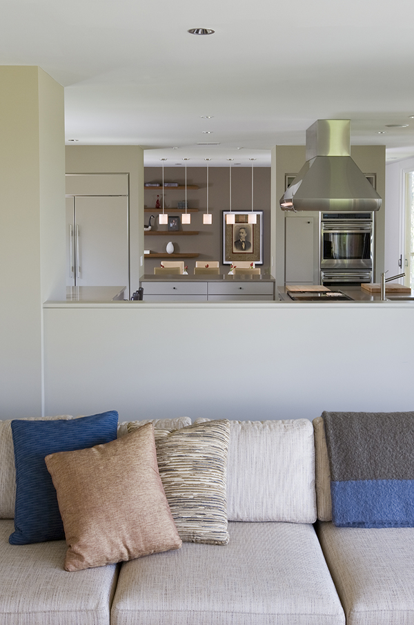 Contemporary open plan living space in warm neutral colors on the Eastern Shore by Washington, DC Architecture and Interior Design firm Studio Santalla