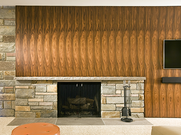 Midcentury inspired asymmetrical basement fireplace feature wall by Washington, DC Architecture and Interior Design firm Studio Santalla
