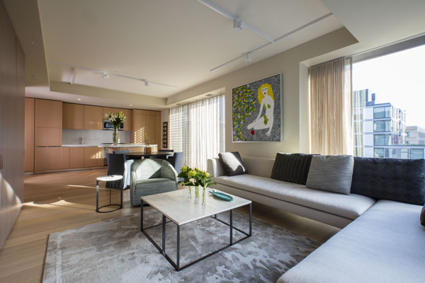 The living space, with contemporary furniture and views of the City Center plaza.