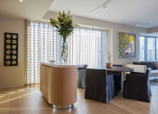 Contemporary furniture in the the Dining space, bathed in natural light from the City Center plaza.